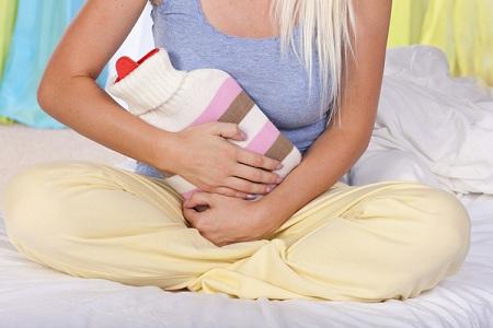 Почему болит бок в конце менструального цикла